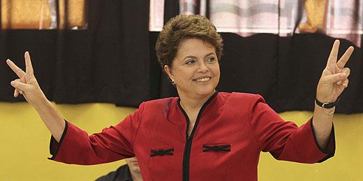 Eleita, Dilma terá desafio de suceder Lula, cuja aprovação bate recordes